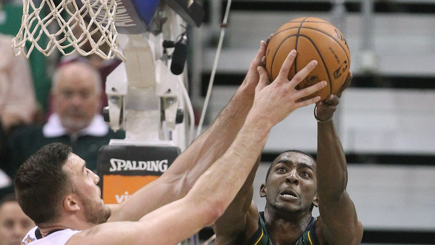Phoenix Suns' Miles Plumlee, left, and Utah Jazz's Jeremy Evans (40) reach for a rebound in the second quarter during an NBA basketball game Friday, Nov. 29, 2013, in Salt Lake City. (AP Photo/Rick Bowmer)