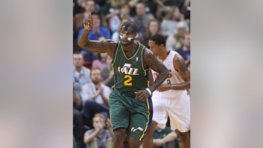 Utah Jazz's Marvin Williams (2) celebrates as he runs up the court after scoring against the Phoenix Suns in the first half during an NBA basketball game Friday, Nov. 29, 2013, in Salt Lake City. (AP Photo/Rick Bowmer)