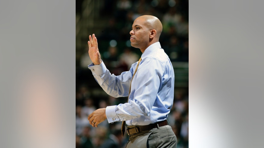 Mount St. Mary's coach Jamion Christian gives instructions to his team during the first half of an NCAA college basketball game against Michigan State, Friday, Nov. 29, 2013, in East Lansing, Mich. Michigan State won 98-65. (AP Photo/Al Goldis)
