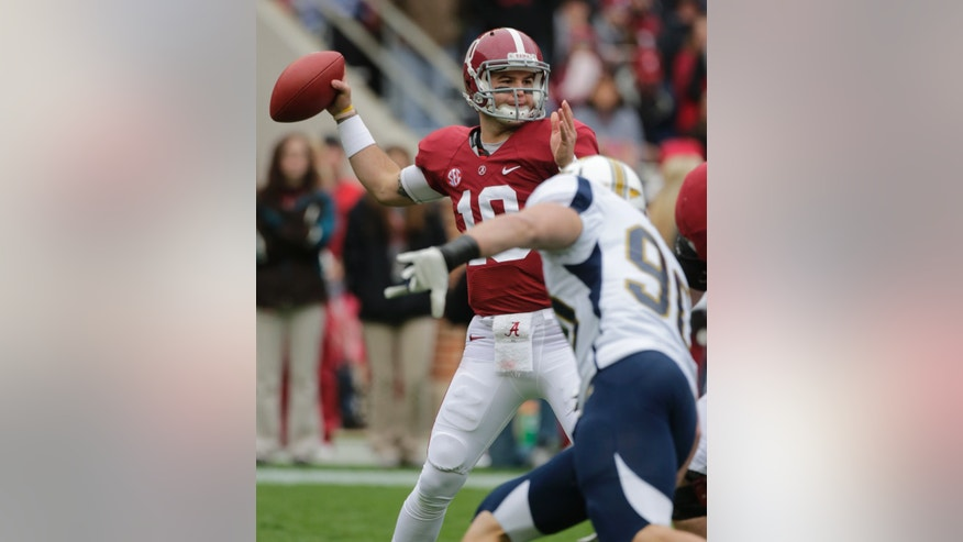 Alabama quarterback AJ McCarron (10) looks for a receiver as Chattanooga defensive lineman Davis Tull (90) rushes in during the first half of an NCAA college football game in Tuscaloosa, Ala., Saturday, Nov. 23, 2013. (AP Photo/Dave Martin)