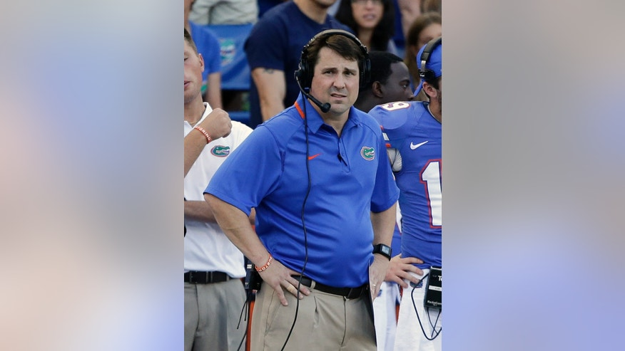 Florida head coach Will Muschamp watches the final minutes of an NCAA college football game against Georgia Southern in Gainesville, Fla., Saturday, Nov. 23, 2013. Georgia Southern won the game 26-20.(AP Photo/John Raoux)