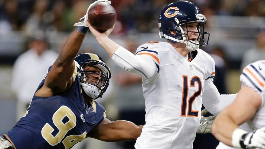 St. Louis Rams defensive end Robert Quinn, left, gets his hand on the ball as Chicago Bears quarterback Josh McCown throws during the first quarter of an NFL football game on Sunday, Nov. 24, 2013, in St. Louis. (AP Photo/Nam Y. Huh)
