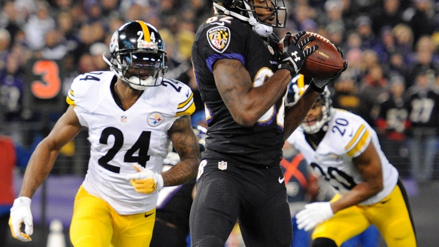 Baltimore Ravens wide receiver Torrey Smith, center, makes a touchdown catch in front of Pittsburgh Steelers cornerback Ike Taylor (24) and strong safety Will Allen in the first half of an NFL football game on Thursday, Nov. 28, 2013, in Baltimore. (AP Photo/Nick Wass)