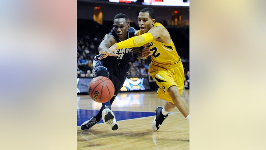 Nevada's Jerry Evans Jr., left and Missouri's Jabari Brown chase a loose ball during the second half of an NCAA college basketball game at the Las Vegas Invitational tournament on Friday, Nov. 29, 2013, in Las Vegas. Missouri won 83-70. (AP Photo/David Becker)