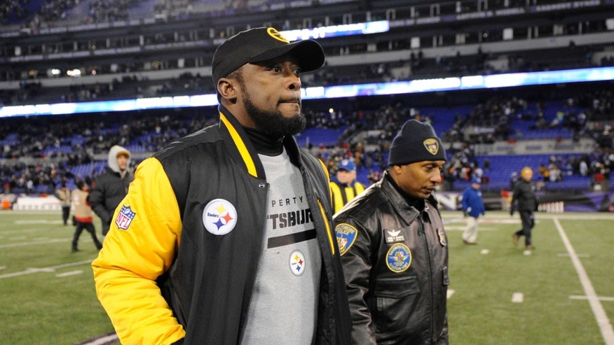 Pittsburgh Steelers coach Mike Tomlin walks off the field after an NFL football game against the Baltimore Ravens, Thursday, Nov. 28, 2013, in Baltimore. Baltimore won 22-20. (AP Photo/Nick Wass)