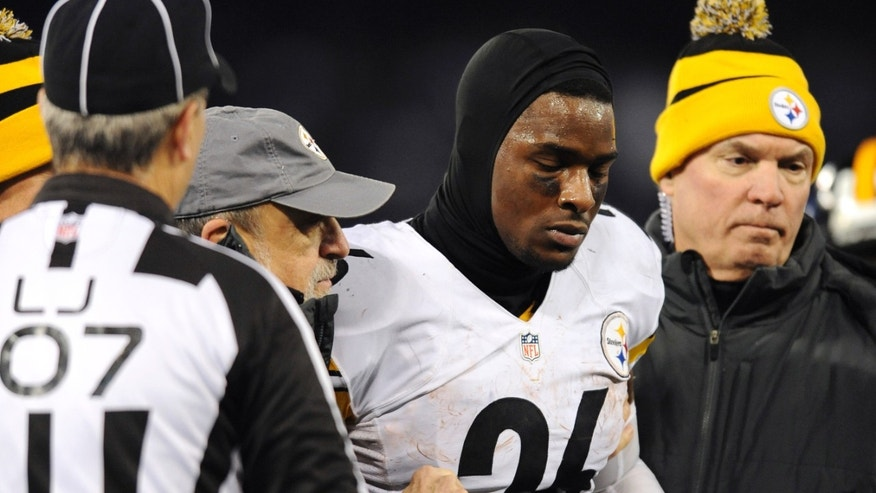 Pittsburgh Steelers running back Le'Veon Bell is assisted off the field after injuring himself during a play in the second half of an NFL football game against the Baltimore Ravens, Thursday, Nov. 28, 2013, in Baltimore. (AP Photo/Gail Burton)