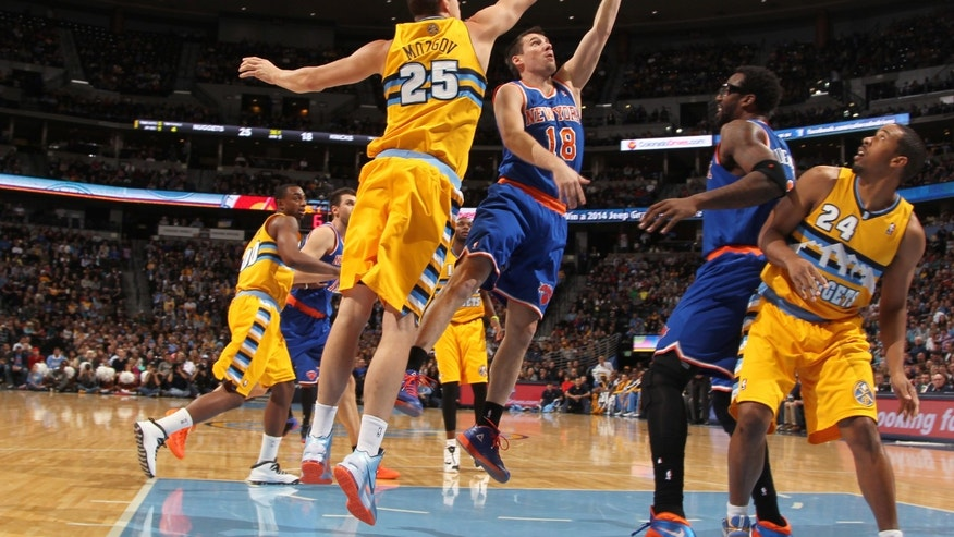 New York Knicks guard Beno Udrih, second from front left, of Slovenia, goes up for shot past Denver Nuggets center Timofey Mozgov, front left, of Russia, as Knicks forward Amare Stoudemire, third from front left, and Nuggets guard Andre Miller (24) look on in the first quarter of an NBA basketball game in Denver, Friday, Nov. 29, 2013. (AP Photo/David Zalubowski)