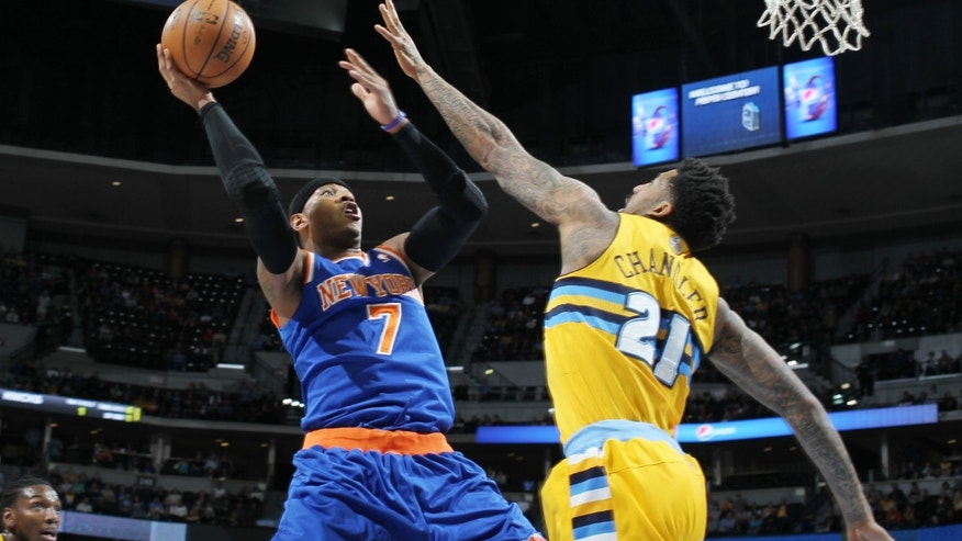 New York Knicks forward Carmelo Anthony (7) goes up to shoot as Denver Nuggets forward Wilson Chandler covers in the first quarter of an NBA basketball game in Denver, Friday, Nov. 29, 2013. (AP Photo/David Zalubowski)