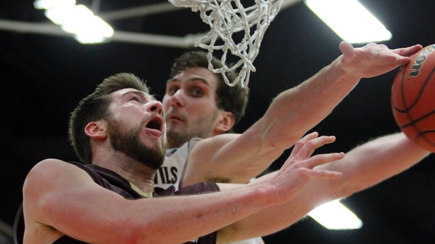 Arizona State center Jordan Bachynski, right, blocks a shot by College of Charleston forward Willis Hall in the second half of an NCAA college basketball game at the Wooden Legacy tournament Friday, Nov. 29, 2013, in Fullerton, Calif. Arizona State won 80-58. (AP Photo/Alex Gallardo)