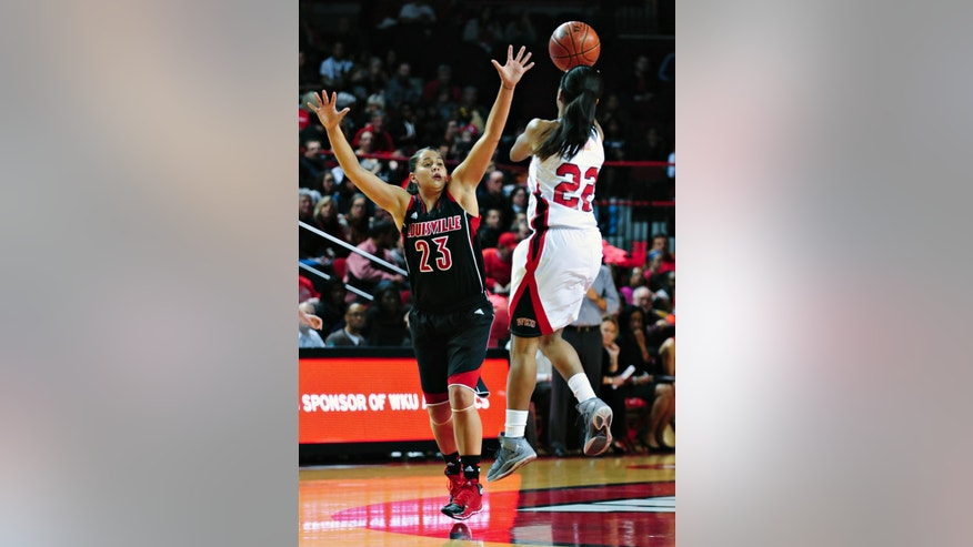 Louisville guard Shoni Schimmel (23) defends as Western Kentucky guard Bianca McGee (22) shoots during an NCAA college basketball game Wednesday, Nov. 27, 2013, at E.A. Diddle Arena in Bowling Green, Ky. (AP Photo/Daily News, Miranda Pederson)