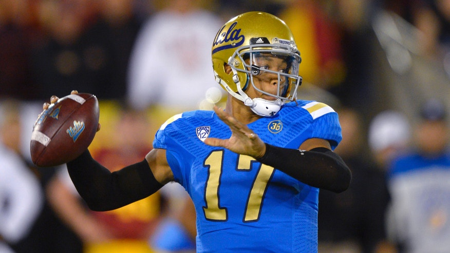 UCLA quarterback Brett Hundley passes during the first half of an NCAA college football game against Southern California, Saturday, Nov. 30, 2013, in Los Angeles. (AP Photo/Mark J. Terrill)