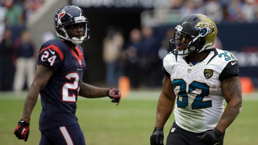 Jacksonville Jaguars running back Maurice Jones-Drew (32) screams after a play against the Houston Texans during the fourth quarter of an NFL football game Sunday, Nov. 24, 2013, in Houston. At left is Houston Texans cornerback Johnathan Joseph (24). (AP Photo/David J. Phillip)