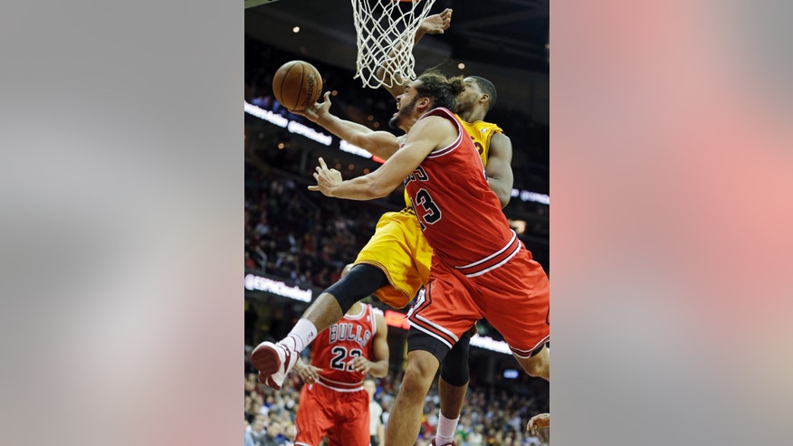 Chicago Bulls' Joakim Noah (13) collides with Cleveland Cavaliers' Tristan Thompson under the basket in the second quarter of an NBA basketball game Saturday, Nov. 30, 2013, in Cleveland. (AP Photo/Mark Duncan)