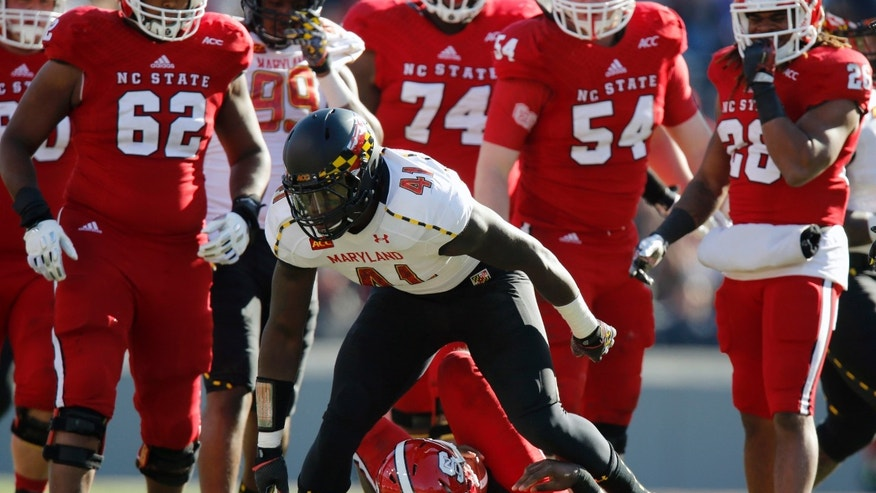 Maryland linebacker Marcus Whitfield (41) gets up after sacking North Carolina State's Brandon Mitchell (8) during the first half of an NCAA college football game on Saturday, Nov. 30, 2013, in Raleigh, N.C. (AP Photo/The News & Observer, Ethan Hyman)