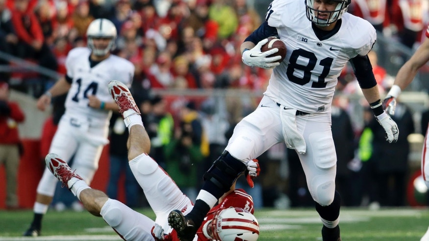 Penn State's Adam Breneman (81) gets past Wisconsin's Nate Hammon for a 68-yard touchdown catch during the first half of an NCAA college football game on Saturday, Nov. 30, 2013, in Madison, Wis. (AP Photo/Morry Gash)
