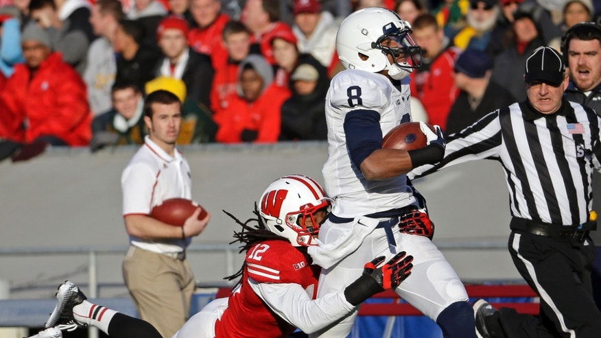 Wisconsin's Dezmen Southward (12) tackles Penn State's Allen Robinson (8) after a 52-yard pass reception during the first half of an NCAA college football game on Saturday, Nov. 30, 2013, in Madison, Wis. (AP Photo/Morry Gash)