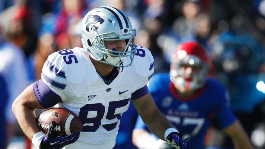 Kansas State tight end Zach Trujillo (85) runs past Kansas linebacker Jake Love (57) for a touchdown reception in the first half of an NCAA college football game in Lawrence, Kan., Saturday, Nov. 30, 2013. (AP Photo/Orlin Wagner)