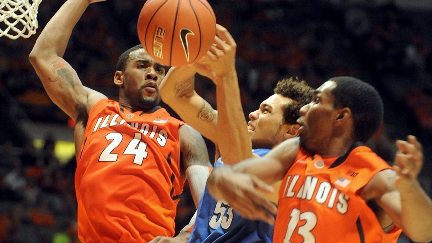 IPFW's Joe Edwards (53) is pressured by Illinois' Rayvonte Rice (24) and Tracy Abrams (13) during the second half of an NCAA college basketball game between IPFW and Illinois at State Farm Center  in Champaign, IL. Illinois won 57-55.   (AP Photo/Heather Coit)