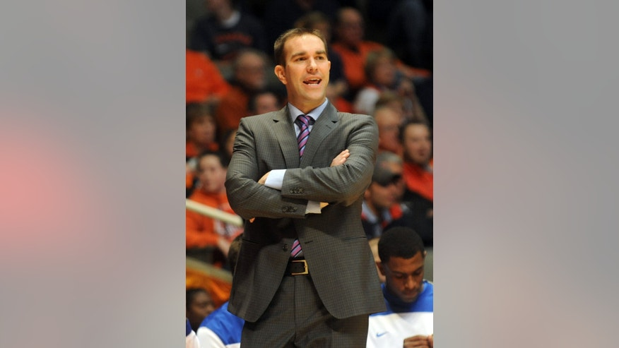 IPFW Coach Tony Jasick watches from the sidelines during the second half of an NCAA college basketball game between IPFW and Illinois at State Farm Center  in Champaign, IL. Illinois won 57-55.   (AP Photo/Heather Coit)