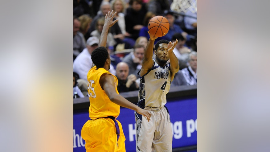 Georgetown guard D'Vauntes Smith-Rivera (4) passes the ball against Lipscomb forward Martin Smith (35) during the second half of an NCAA college basketball game, Saturday, Nov. 30, 2013, in Washington. Georgetown won 70-49. (AP Photo/Nick Wass)