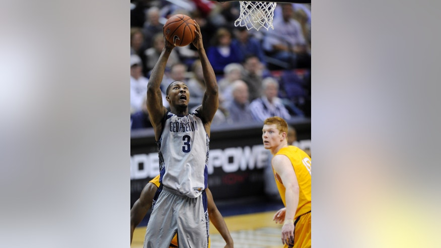 Georgetown forward Mikael Hopkins (3) goes to the basket against Lipscomb guard Talbott Denny, right, during the second half of an NCAA college basketball game, Saturday, Nov. 30, 2013, in Washington. Georgetown won 70-49. (AP Photo/Nick Wass)