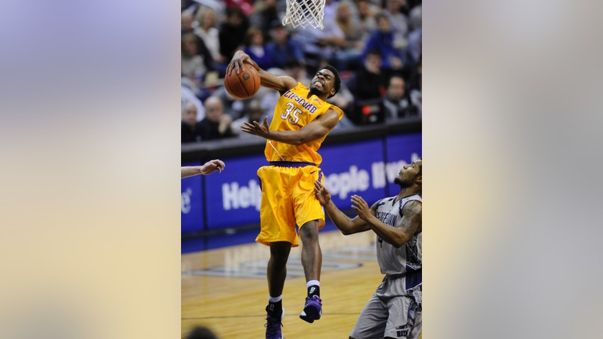 Lipscomb forward Martin Smith (35) grabs a rebound against Georgetown guard D'Vauntes Smith-Rivera (4) during the second half of an NCAA college basketball game, Saturday, Nov. 30, 2013, in Washington. Georgetown won 70-49. (AP Photo/Nick Wass)