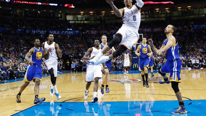 Oklahoma City Thunder guard Russell Westbrook (0) goes up for a shot against the Golden State Warriors in the second quarter of an NBA basketball game in Oklahoma City, Friday, Nov. 29, 2013. (AP Photo/Sue Ogrocki)