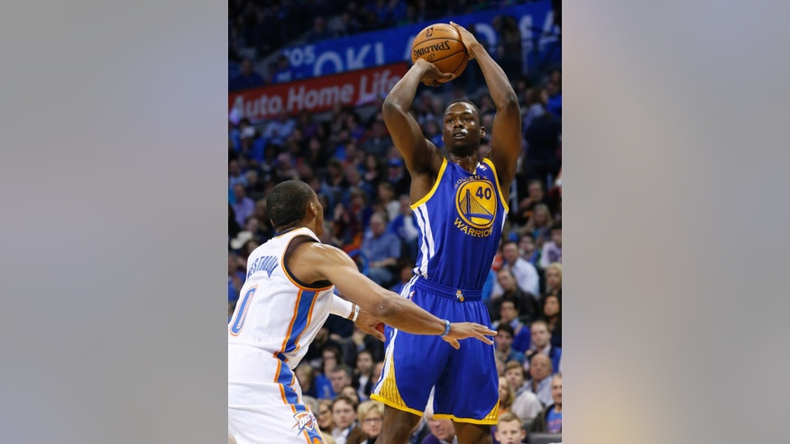 Golden State Warriors forward Harrison Barnes (40) shoots over Oklahoma City Thunder guard Russell Westbrook (0) in the first quarter of an NBA basketball game in Oklahoma City, Friday, Nov. 29, 2013. (AP Photo/Sue Ogrocki)
