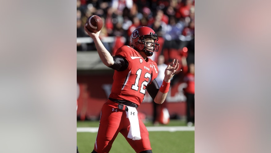 Utah quarterback Adam Schulz (12) passes the ball in the second quarter of an NCAA college football game against Colorado Saturday, Nov. 30, 2013, in Salt Lake City. (AP Photo/Rick Bowmer)