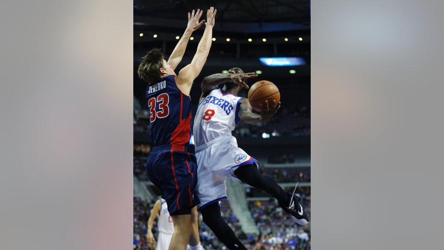 Philadelphia 76ers guard Tony Wroten (8) goes to the basket against Detroit Pistons forward Jonas Jerebko (33), of Sweden, during the first half of an NBA basketball game on Sunday, Dec. 1, 2013, in Auburn Hills, Mich. (AP Photo/Duane Burleson)