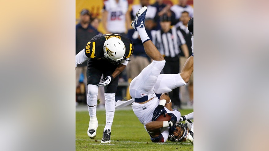 Arizona State's Damarious Randall, left, upends Arizona's Trey Griffey during the first half of an NCAA college football game Saturday, Nov. 30, 2013, in Tempe, Ariz. (AP Photo/Ross D. Franklin)