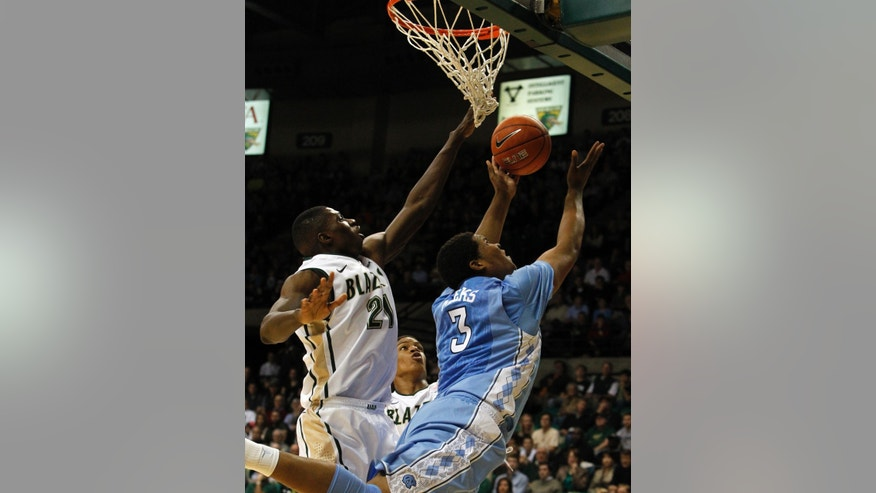 North Carolina forward Kennedy Meeks (3) puts up a reverse layup as UAB forward Tosin Mehinti (21) tries to block it during the first half of an NCAA college basketball game on Sunday, Dec. 1, 2013, in Birmingham, Ala. (AP Photo/Butch Dill)