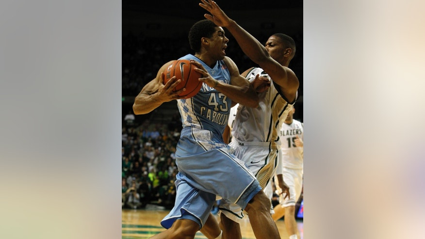North Carolina forward James Michael McAdoo (43) tries to power to the basket as UAB forward Rod Rucker (42) blocks him during the first half of an NCAA college basketball game on Sunday, Dec. 1, 2013, in Birmingham, Ala. (AP Photo/Butch Dill)