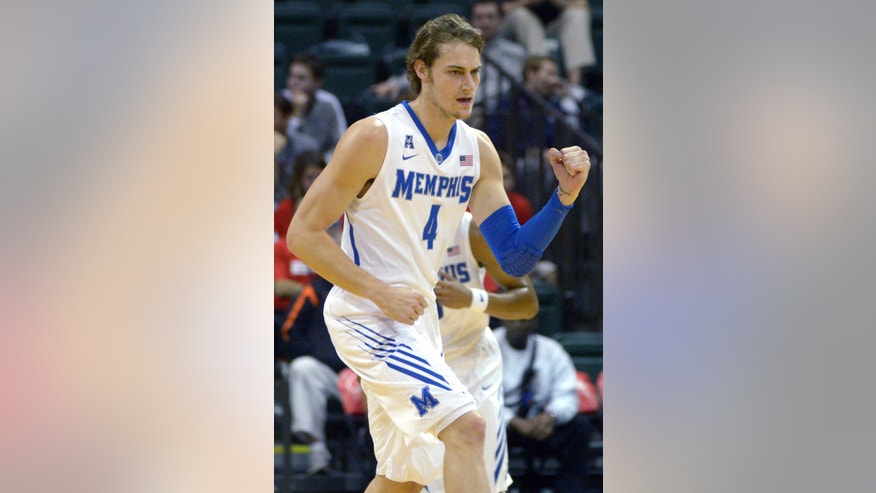 Memphis forward Austin Nichols (4) celebrates after scoring during the first half of an NCAA college basketball game against Oklahoma State at the Old Spice Classic tournament in Kissimmee, Fla., Sunday, Dec. 1, 2013.(AP Photo/Phelan M. Ebenhack)