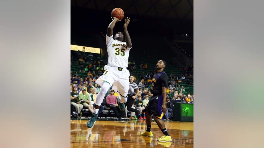 Baylor forward Taurean Prince (35) drives past Hardin-Simmons John Barnes in the first half of an NCAA college basketball game Sunday, Dec. 1, 2013, in Waco, Texas. (AP Photo/The Waco Tribune-Herald, Rod Aydelotte)