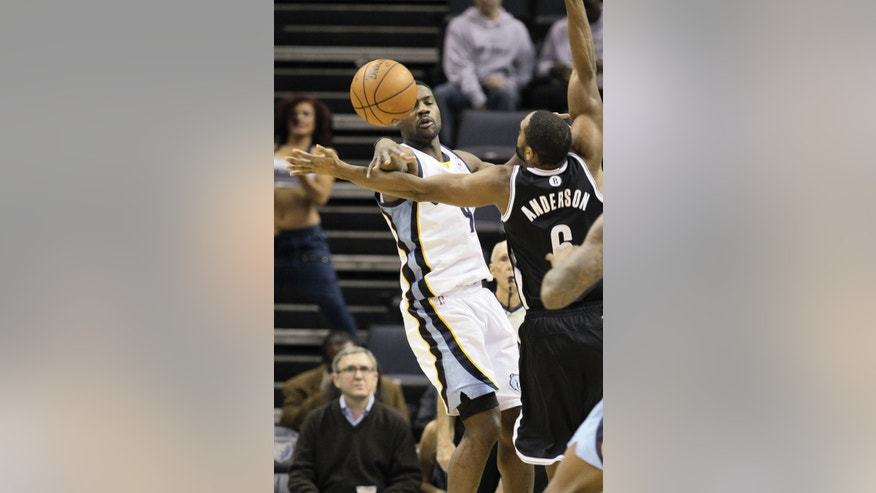 Memphis Grizzlies' Tony Allen, left, passes the ball in front of Brooklyn Nets' Alan Anderson in the first half of an NBA basketball game in Memphis, Tenn., Saturday, Nov. 30, 2013. (AP Photo/Danny Johnston)