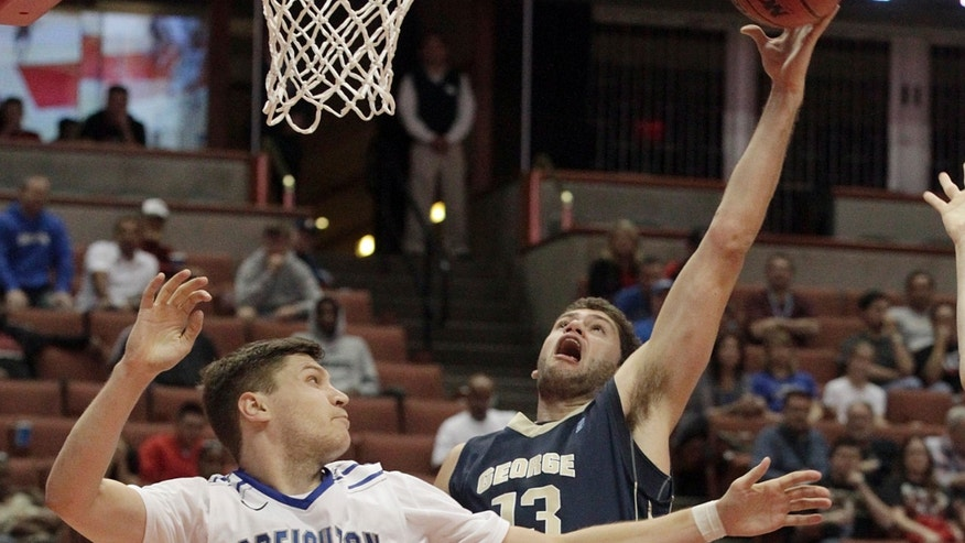 George Washington University guard/forward Patricio Garino (13) shoots over Creighton guard Grant Gibbs (10) in the second half of an NCAA men's college basketball game at the Wooden Legacy tournament in Anaheim, Calif., Sunday, Dec. 1, 2013.  George Washington won, 60-53. (AP Photo/Reed Saxon)