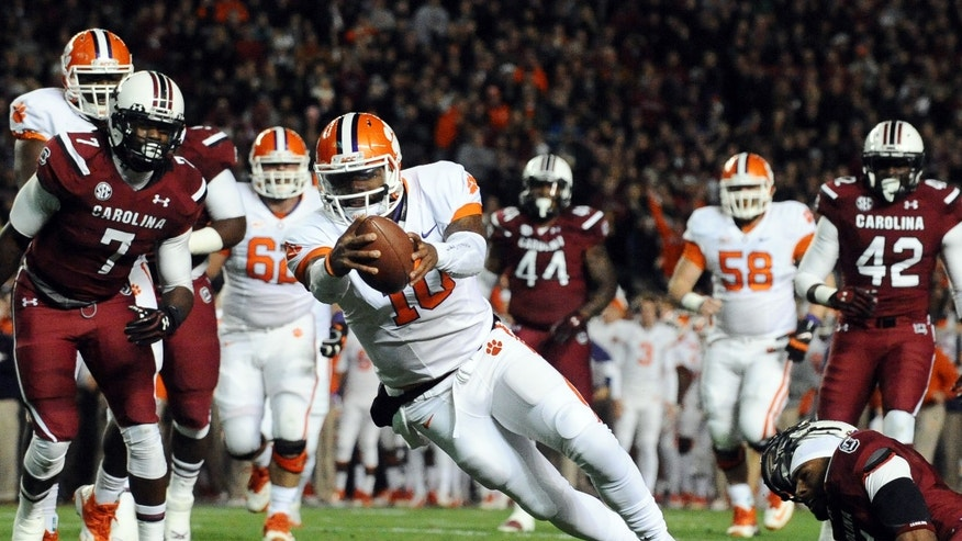 Clemson quarterback Tajh Boyd (10) dives into the end zone for a touchdown during the first half of an NCAA college football game against South Carolina on Saturday, Nov 30, 2013, in Columbia, S.C. (AP Photo/Rainier Ehrhardt)