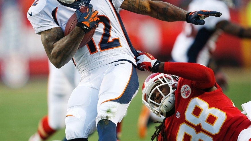 Kansas City Chiefs wide receiver Junior Hemingway (88) tackles Denver Broncos wide receiver Andre Caldwell (12) during the first half of an NFL football game, Sunday, Dec. 1, 2013, in Kansas City, Mo. (AP Photo/Orlin Wagner)