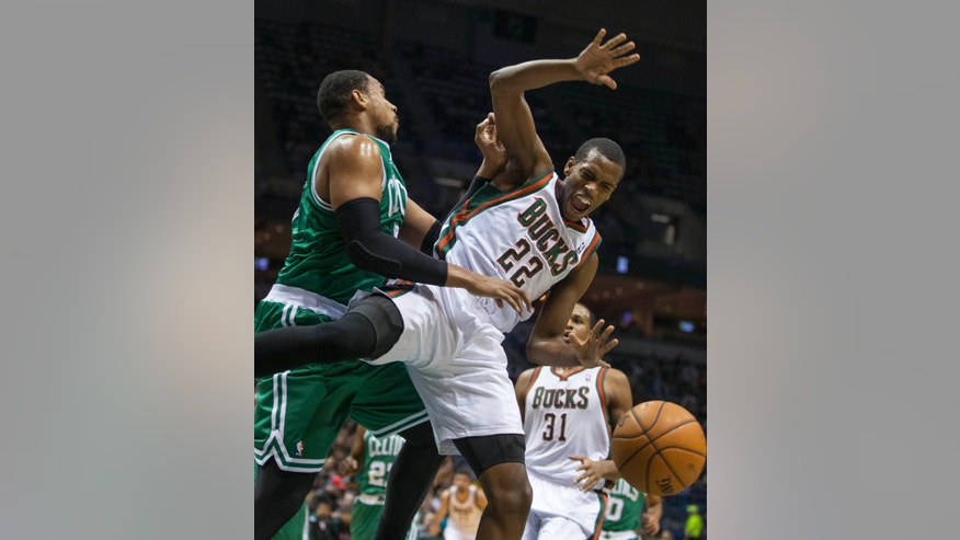 Milwaukee Bucks' Khris Middleton is fouled by Boston Celtics' Jared Sullinger during the second half of an NBA basketball game Saturday, Nov. 30, 2013, in Milwaukee. (AP Photo/Tom Lynn)