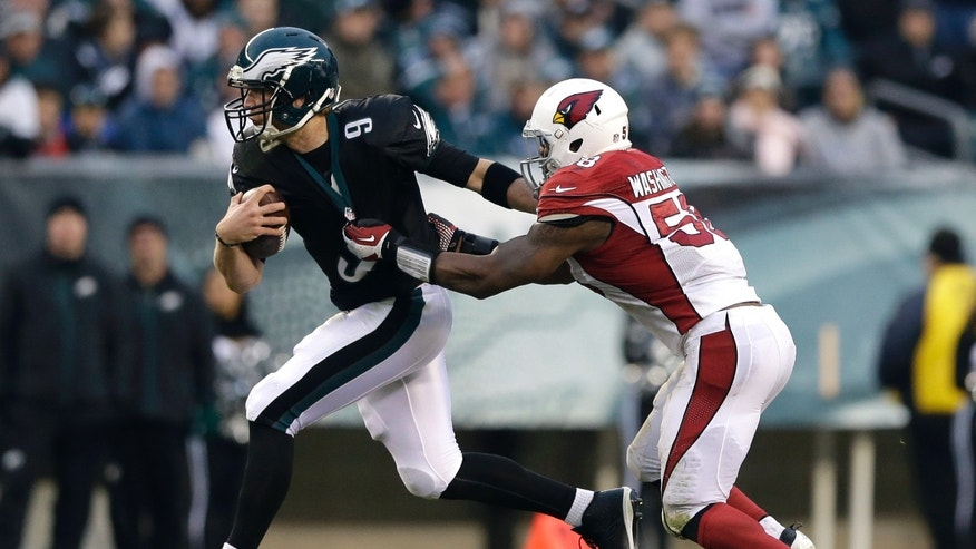 Philadelphia Eagles' Nick Foles, left, is tackled by Arizona Cardinals' Daryl Washington during the second half of an NFL football game on Sunday, Dec. 1, 2013, in Philadelphia. (AP Photo/Matt Rourke)