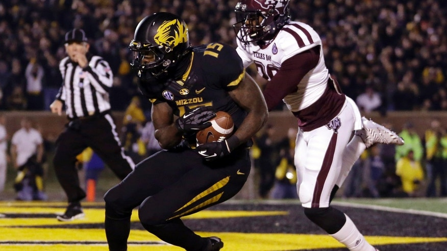 Missouri wide receiver Dorial Green-Beckham, left, catches a 38-yard touchdown pass as Texas A&M defensive back Deshazor Everett defends during the second quarter of an NCAA college football game on Saturday, Nov. 30, 2013, in Columbia, Mo. (AP Photo/Jeff Roberson)