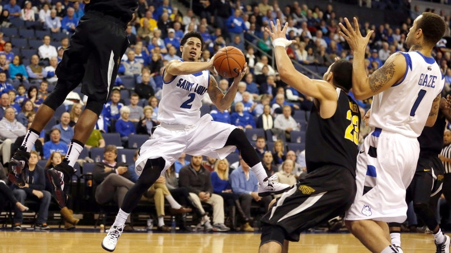 Saint Louis' Austin McBroom (2) passes to teammate Grandy Glaze (1) as Wichita State's Cleanthony Early (11) and Fred VanVleet defend during the first half of an NCAA college basketball game on Sunday, Dec. 1, 2013, in St. Louis. (AP Photo/Jeff Roberson)