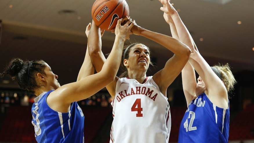 Oklahoma's Nicole Griffin (4) takes a shot against Creighton's Alexis Akin-Otiko (45) and Sarah Nelson (42) during the first half of an NCAA college basketball game in Norman, Okla., Sunday, Dec. 1, 2013. (AP Photo/Garett Ray Fisbeck)