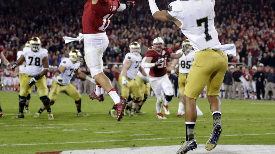 Notre Dame wide receiver TJ Jones, right, catches a touchdown pass in front of Stanford linebacker Shayne Skov (11) during the second half of an NCAA college football game on Saturday, Nov. 30, 2013, in Stanford, Calif. Stanford won 27-20. (AP Photo/Marcio Jose Sanchez)