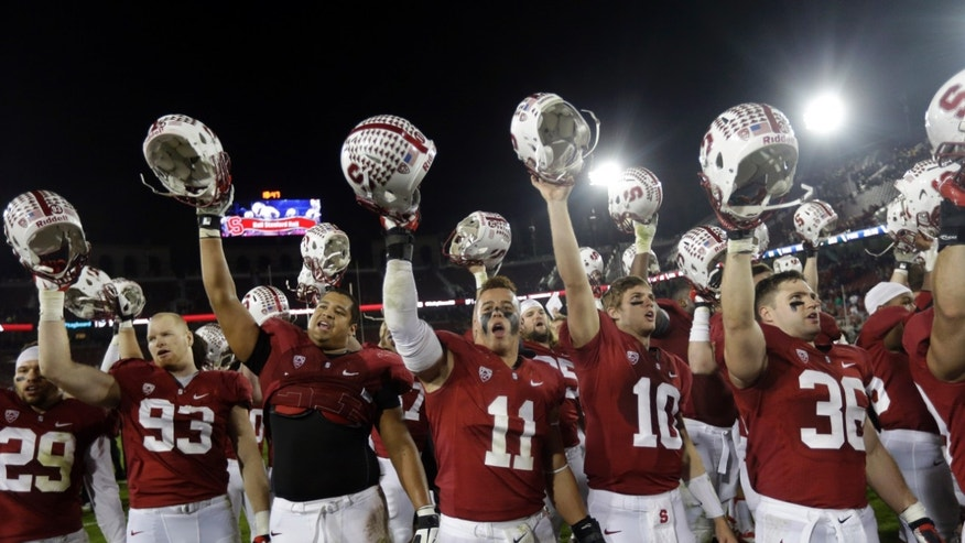 Stanford players celebrate after a 27-20 win over Notre Dame during an NCAA college football game on Saturday, Nov. 30, 2013, in Stanford, Calif. (AP Photo/Marcio Jose Sanchez)