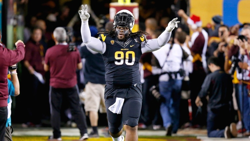 Arizona State's Will Sutton runs onto the field before an NCAA college football game against Arizona on Saturday, Nov. 30, 2013, in Tempe, Ariz. Arizona State defeated Arizona 58-21. (AP Photo/Ross D. Franklin)