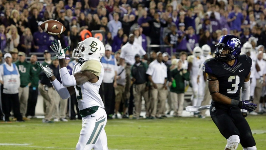 Baylor safety Terrell Burt (13) intercepts a pass in the end zone in front of TCU wide receiver Brandon Carter (3) during the final minute of an NCAA college football game Saturday, Nov. 30, 2013, in Fort Worth, Texas. Baylor won 41-38. (AP Photo/LM Otero)