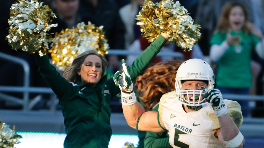 Baylor linebacker Eddie Lackey (5) celebrates after returning an interception for a touchdown in the third quarter of a 41-38 win  during an NCAA college football game against TCU in Fort Worth, Texas, Saturday, Nov. 30, 2013. (AP Photo/Dallas Morning News, Louis DeLuca) MANDATORY CREDIT; NO SALES; MAGAZINES OUT; TV OUT; INTERNET USE BY AP MEMBERS ONLY
