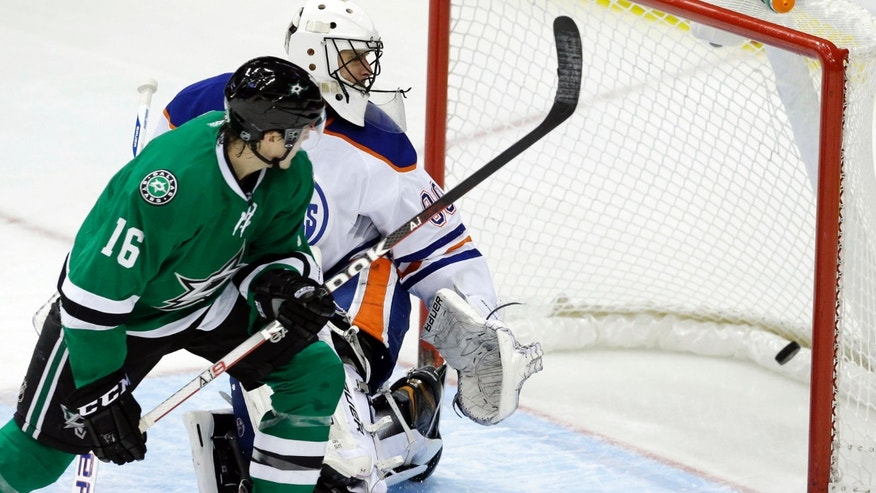 Dallas Stars left wing Ryan Garbutt (16) scores a goal against Edmonton Oilers goalie Ilya Bryzgalov during the second period of an NHL hockey game Sunday, Dec. 1, 2013, in Dallas. (AP Photo/LM Otero)